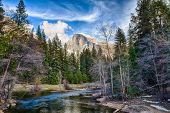 picture of granite dome  - Half Dome towers above the Merced river. Yosemite National Park California