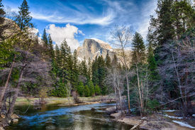 image of granite dome  - Half Dome towers above the Merced river. Yosemite National Park California