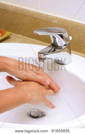 Washing Hands In Sink.