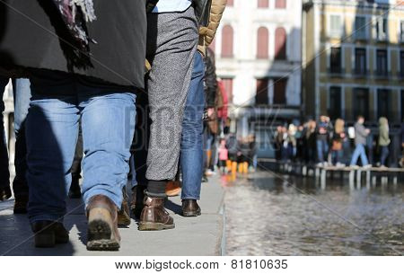 People Walking on the catwalk In Venice
