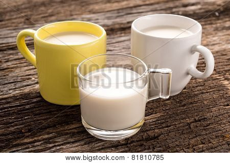 Fresh Glass Of Milk On Old Wood Background