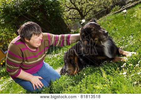 Disabled Woman On A Lawn With Dog