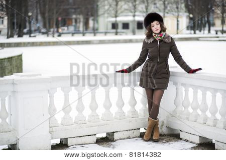A Snow Behind A Beautiful Young Woman