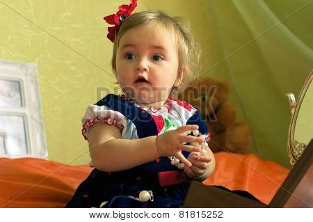 Dressed Small Girl Plays With Circlet And Casket