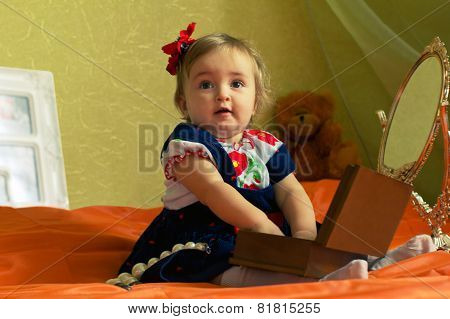 Dressed Small Girl Plays With Casket