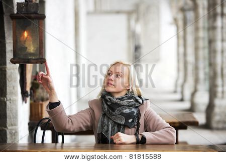 Woman Dangerously Touching The Lantern