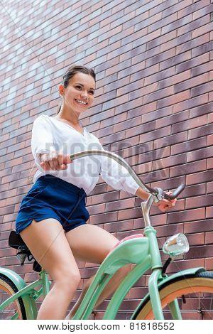 Riding Her Vintage Bike.