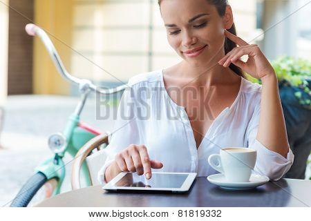 Enjoying Coffee Break In Cafe.