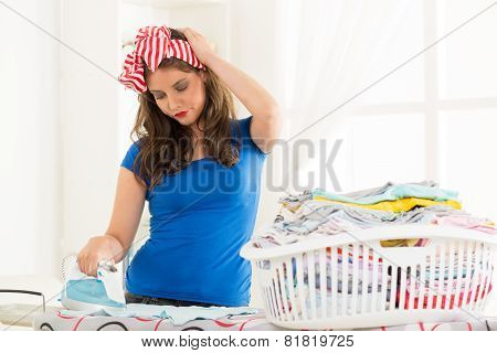 Young Housewife Ironing The Laundry