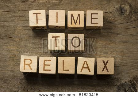 Time To Relax text on a wooden cubes