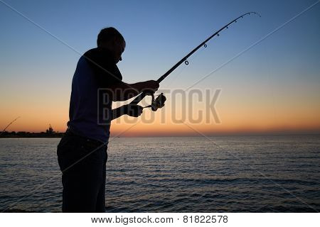 Fisherman Fishes At The