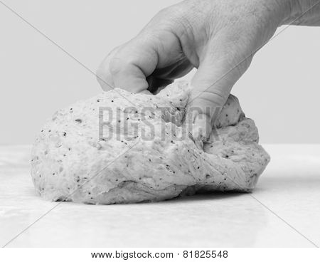Woman's Hand Kneading Bread Dough