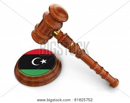 Wooden Mallet and Libyan flag (clipping path included)