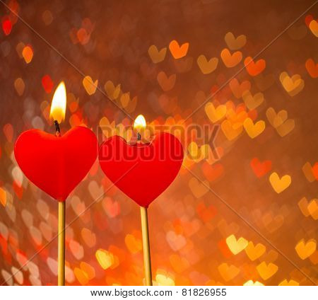 Red Hearts Candles On Warm Hearts Bokeh As Background