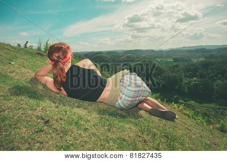 Woman Lying On Hillside And Admiring View
