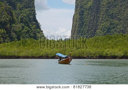 Wooden Thai national boat on the background of the mangroves. Thailand, Andaman Sea