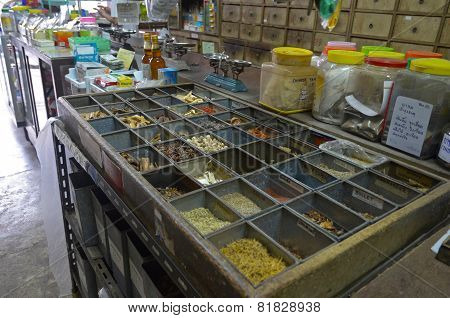 Phuket,TH-Sept,22 2014:Containers with dried herbs in The Oldest Herbs Shop in the Old Town. Phuket,