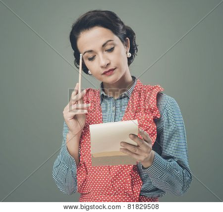 Housewife Writing Down A Shopping List