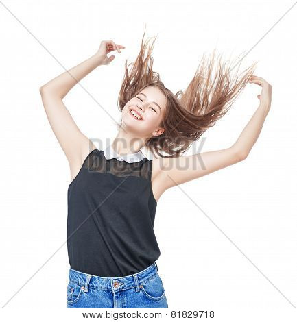 Happy Young Teenager Girl With Hands Up And Fluttering Hair