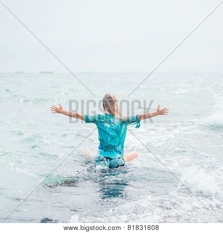 Woman meditating at the sea