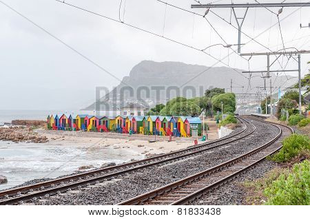 Multi-colored Beach Huts At St. James With Railroad Passing By