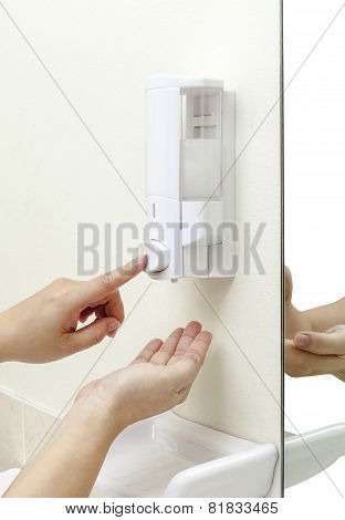 Woman Pressing The Hand Gel To Her Hand