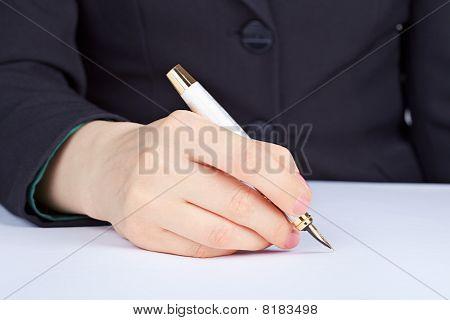 Person Undersigns An Golden Pen