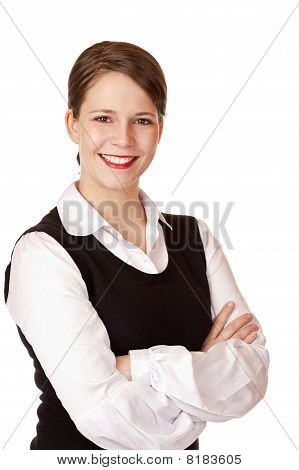 Business woman with crossed arms looks laughs happy into camera.
