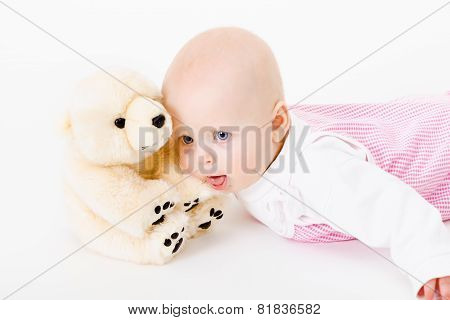 Blue-eyed Baby With A Soft Toy. Studio Photo