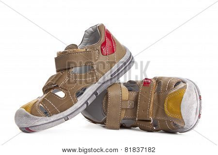 Brown Shoes For Kids Isolated Over A White Background