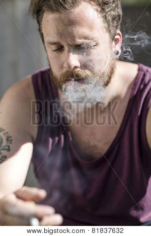 Close up of man who smokes on the staircase