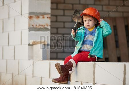 girl with helmet working on construction