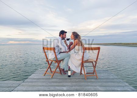 Couple Drinking Red Wine At The Seaside