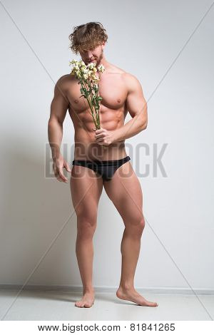 athletic man with a withered flowers