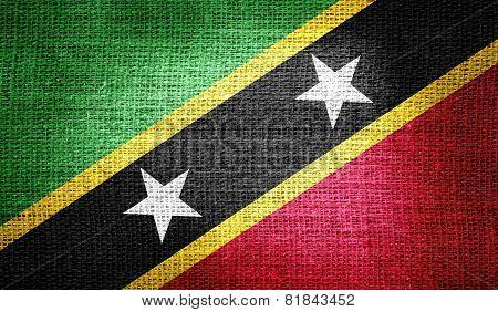 Saint Kitts and Nevis flag on burlap fabric
