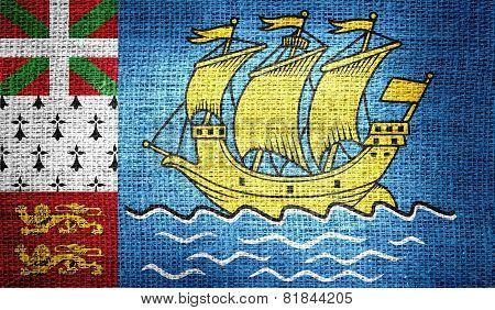 Saint Pierre and Miquelon flag on burlap fabric