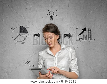 Woman on concrete wall with business sketches