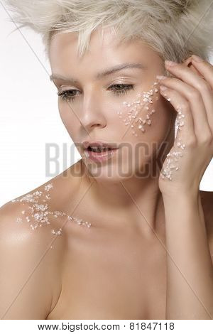 Blond Model Applying A Scrub Treatment On The Body An Face
