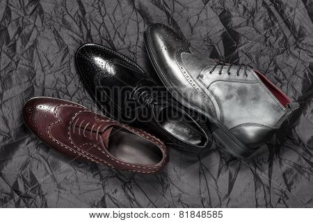 Set of man footwear on a black background