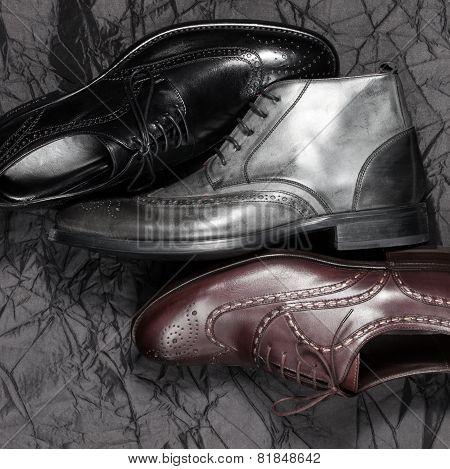 Set of man footwear on a black background