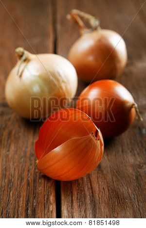 Onions And Peel On An Old Rural Table