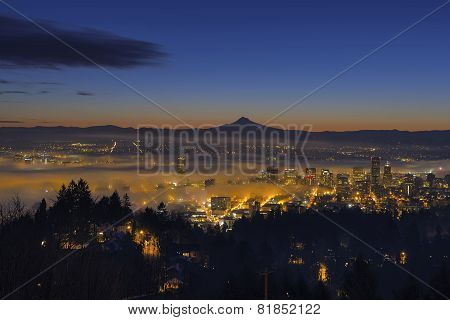 Fog Rolling In At Dawn Over The Cityscape Of Portland