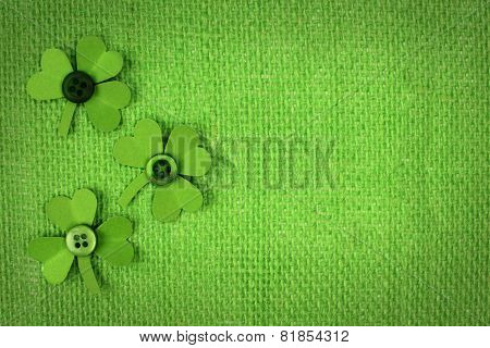 St Patricks Day burlap background with shamrocks
