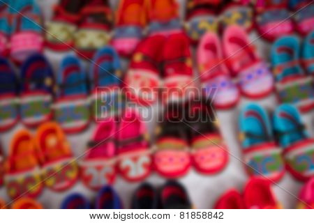 Blurry Image Of Handmade Kid Shoe