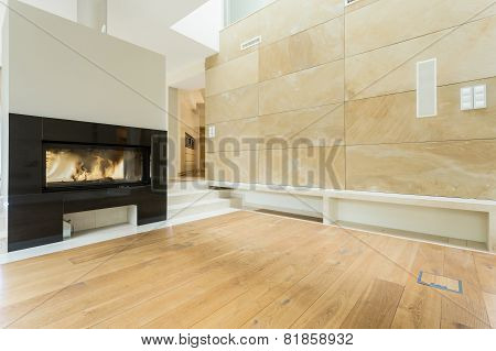 Burning Fireplace In Beige House