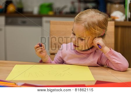 Cute Girl Drawing Hands At The Paper