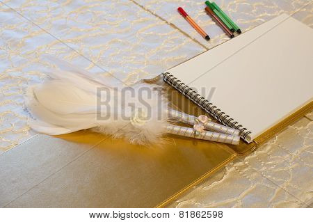 Photo Of A Wedding Register And Feather Pen. Wedding Guestbook.