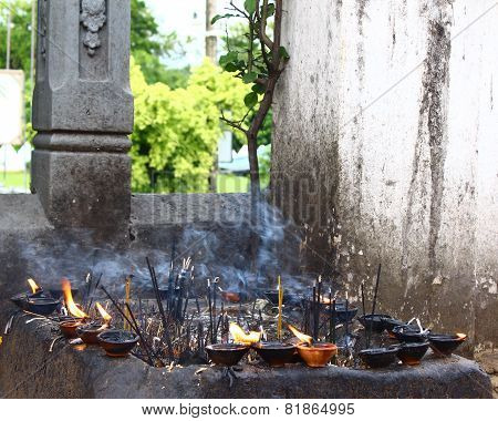burning incense in a Buddhist temple