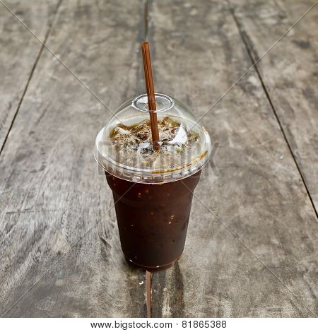 Delicious Ice Coffee Americano On Old Wood Table.