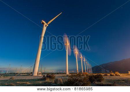 Wind Turbines In Desert During Sunrise Time